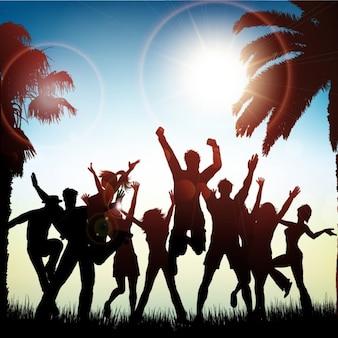 Paisaje de verano con personas saltando