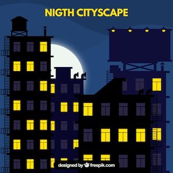Paisaje urbano nocturno con ventanas iluminadas
