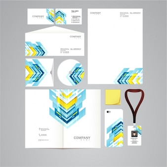 Papelería corporativa con formas azules y amarillas