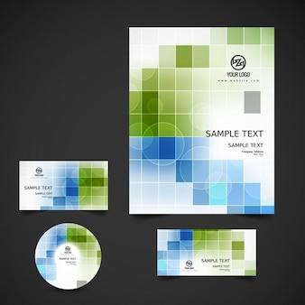 Papelería de negocio con cuadrados verdes y azules