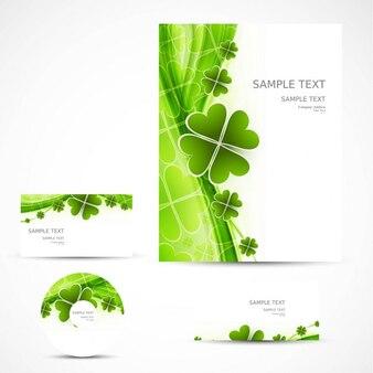Papelería de negocios con tréboles verdes