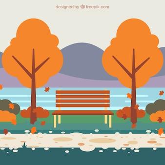 Parque y banco durante el otoño