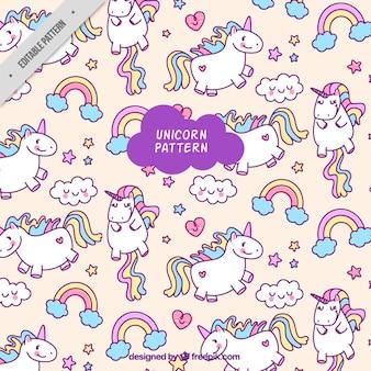 Patrón colorido de unicornios