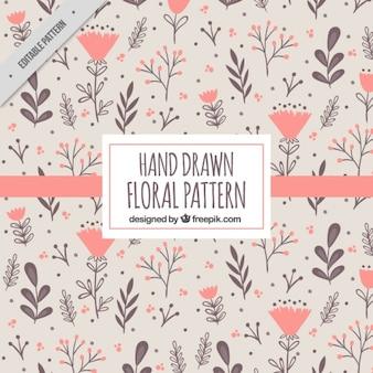 Patrón con flores dibujadas en colores cálidos