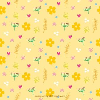 Patrón amarillo de flores y corazones
