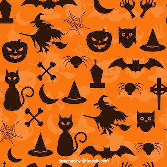 Patrón anaranjado con las siluetas de halloween
