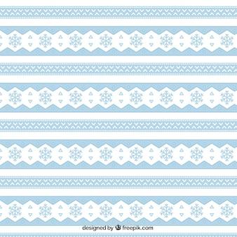 Patrón azul étnico de copos de nieve