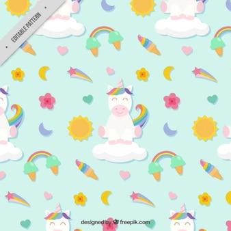 Patrón con adorable unicornio y elementos bonitos