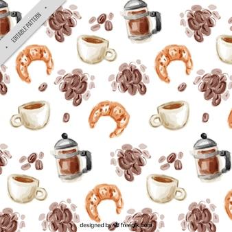 Patrón de acuarela con granos de café y croissants