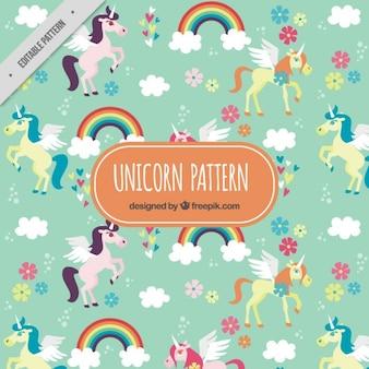 Patrón de adorables unicornios con arcoiris y flores