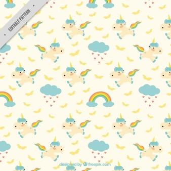 Patrón de adorables unicornios con arcoiris y nubes