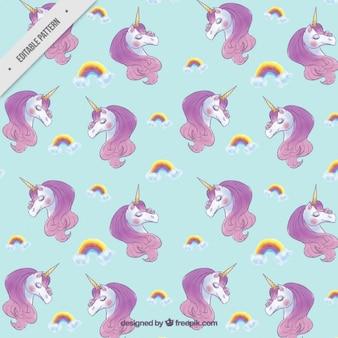Patrón de bonitos unicornios con arcoiris
