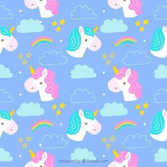 Patrón de bonitos unicornios dibujados a mano
