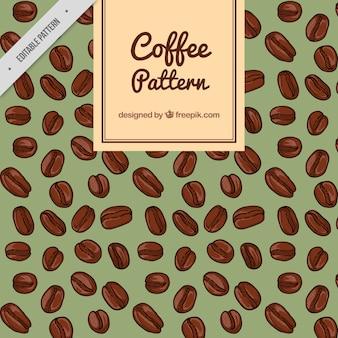 Patrón de café con granos de café dibujados a mano