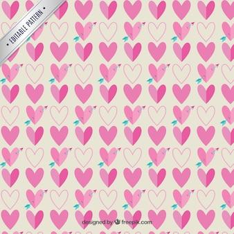 Patrón de corazones rosados