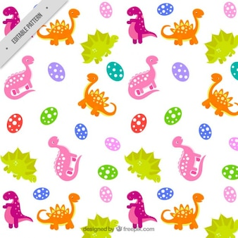 Patrón de dinosaurios rosas, naranjas y verdes