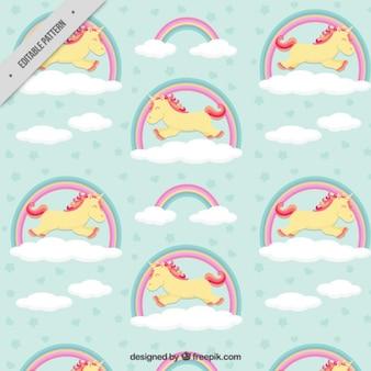 Patrón de feliz unicornio con arcoiris
