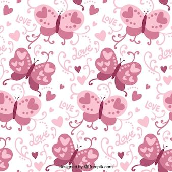 Patrón de mariposas decorativas rosa y corazones