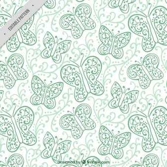 Patrón de mariposas ornamentales dibujadas a mano