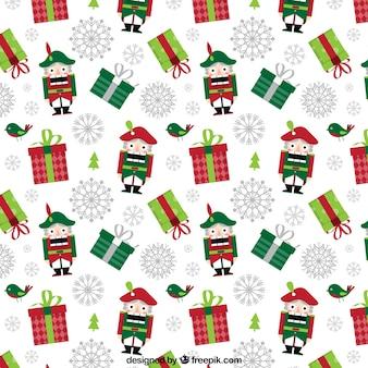 Patrón de navidad con regalos y cascanueces