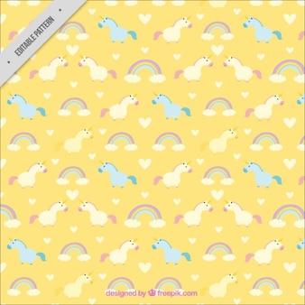 Patrón de pequeños unicornio con arcoiris