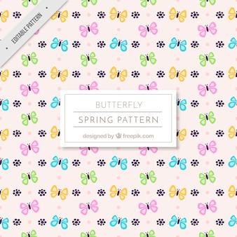 Patrón de primavera de mariposas decorativas