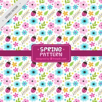 Patrón de primavera fantástico con flores y mariquitas