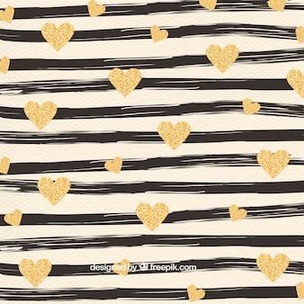 Patrón de rayas pintadas a mano y corazones dorados