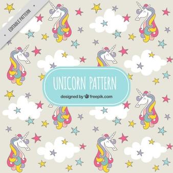 Patrón de unicornio de colores con estrellas