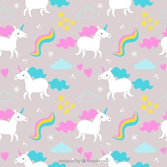 Patrón de unicornios de colores con elementos