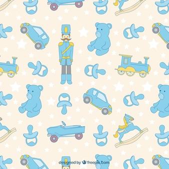 Patrón fantástico con juguetes para bebés y estrellas
