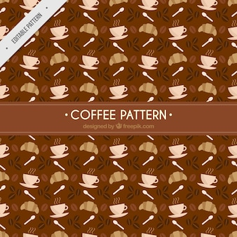Patrón marrón con croissants y tazas de café