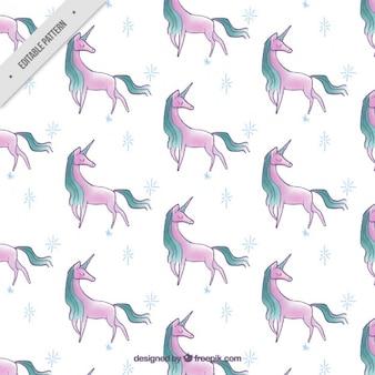 Patrónde unicornios rosas dibujados a mano