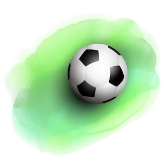 Pelota de fútbol en un fondo de acuarela