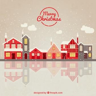Pueblo rojo de navidad nevado