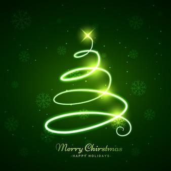 Resplandeciente árbol de Navidad en fondo verde
