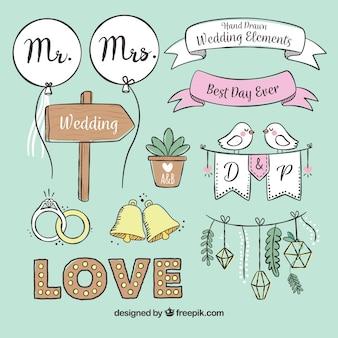 Selección dibujada a mano de elementos de boda decorativos