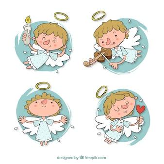 Set de adorable ángel en diferentes posturas dibujados a mano