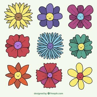 Set de bonitas flores con caras dibujadas a mano