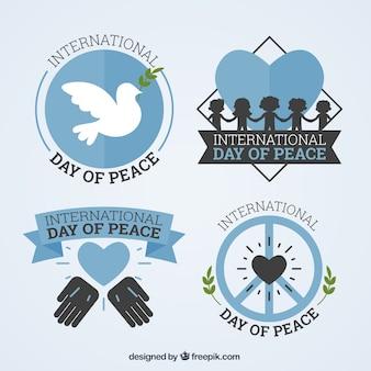 Set de bonitas insignias del día de la paz en diseño plano