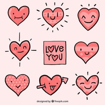 Set de corazones con caras dibujados a mano