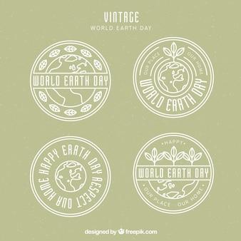Set de cuatro insignias redondas para el día de la madre tierra