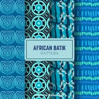 Set de cuatro patrones dibujados a mano en tonos azules
