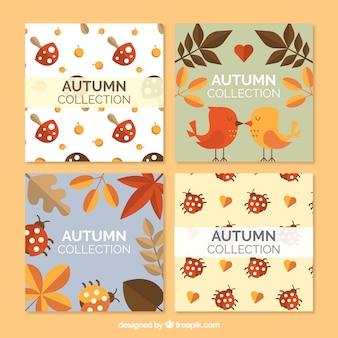Set de cuatro tarjetas de otoño con elementos naturales en estilo vintage