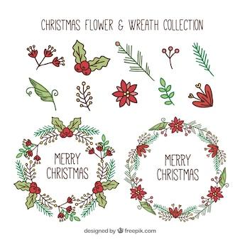 Set de elementos naturales dibujados a mano y coronas de navidad