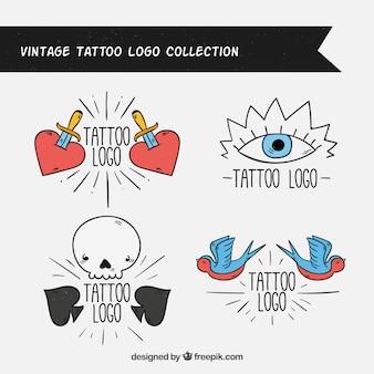 Set de logos de tatuajes retro dibujados a mano