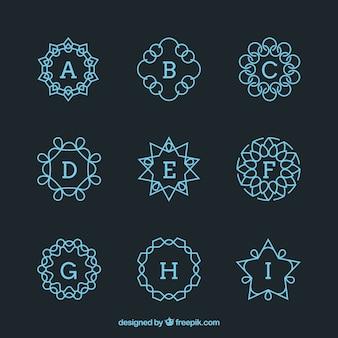 Set de monogramas geométricos de color azul
