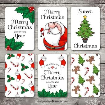 Set de tarjetas de feliz navidad y año nuevo dibujadas a mano