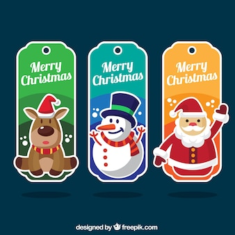 Set de tres etiquetas coloridas con personajes navideños