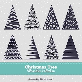 Siluetas de árbol de navidad azul oscuro